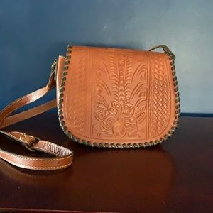 Patricia Nash tooled leather saddle bag